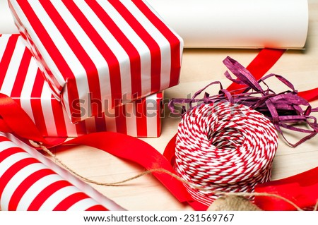 Christmas preparation. Ribbons and accessories for Xmas gift packing on wood floor
