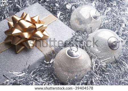 Christmas present and beautiful silver christmas setting with baubles