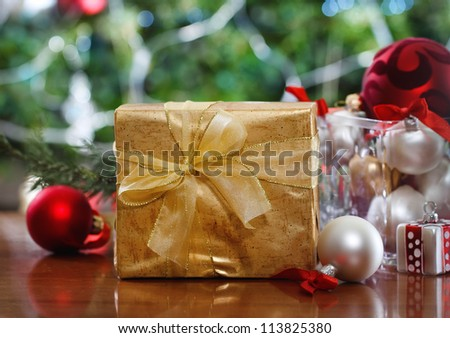 Christmas present and decorations in front of Christmas tree
