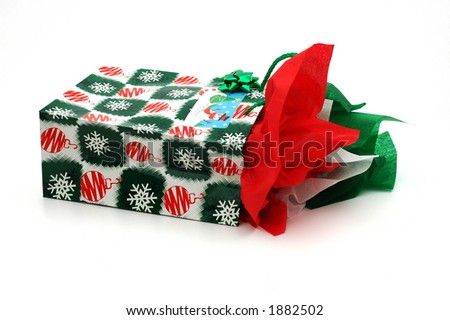 Christmas present in a gift bag isolated on a white background