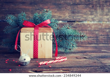Christmas present on dark wooden background in vintage style