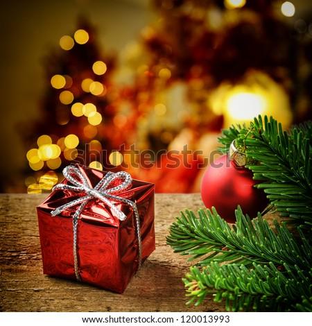 Christmas present on festive lighted background
