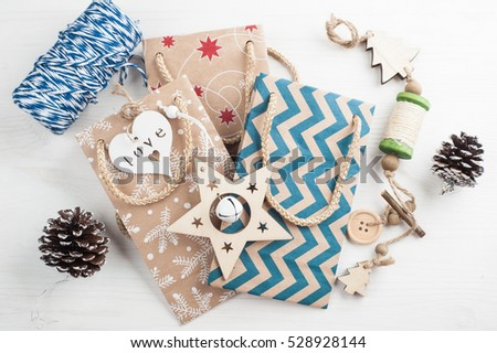 Christmas present packaging, wrapping twine, wooden vintage toys. Modern lifestyle composition in scandinavian style #528928144