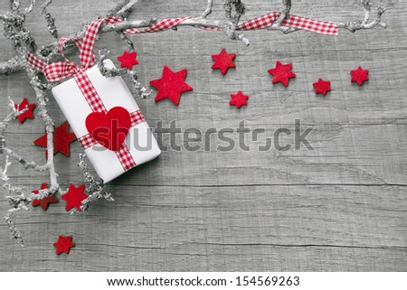 Christmas present wrapped in paper as background with a red heard