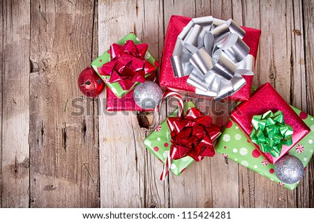 Christmas Presents and Ornaments on Wooden Background