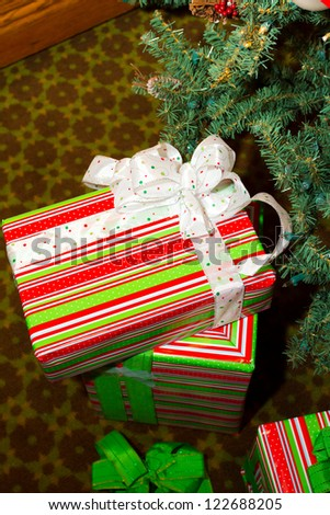 Christmas presents are wrapped and placed under the tree for the December winter holiday.