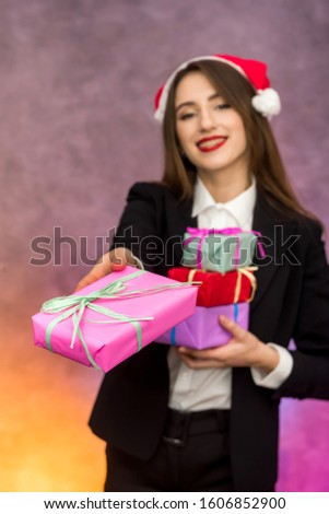 Christmas presents concept. Beautiful woman holding colorful present boxes