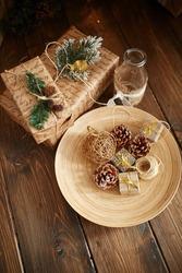 Christmas presents in craft paper on wooden floor
