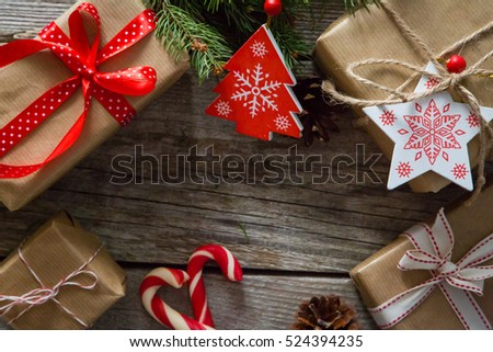 christmas presents in decorative boxes, white wood background #524394235