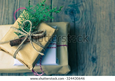 Christmas presents in rustic style with holiday decorations, selective focus