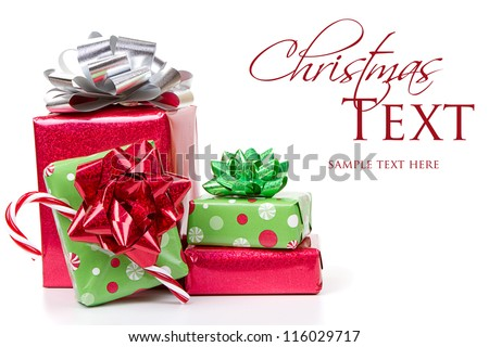 Christmas presents stacked up on white background