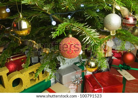 Christmas presents under an illuminated Christmas Tree