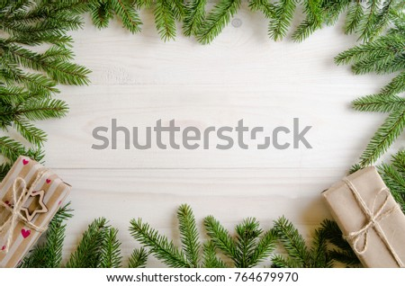 Christmas presents with a Christmas tree on a white wooden background. new Year gifts - Shutterstock ID 764679970