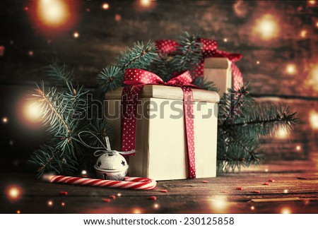 Christmas presents with red ribbon on dark wooden background in vintage style #230125858