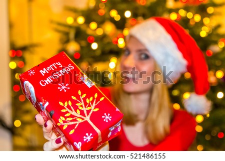Christmas presents, woman holds presents #521486155