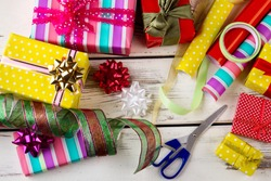 Christmas presents, wrapping papers and accessories. Active preparation for the Christmas holidays.