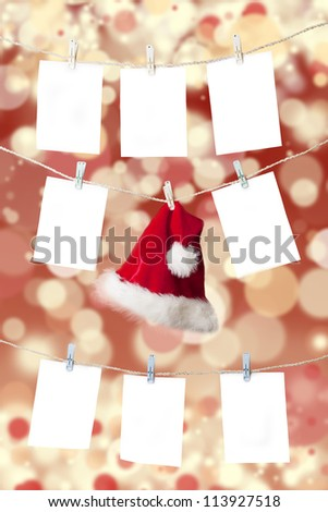 Christmas pricing tags and santa's hat hanging on the rope with christmas defocused light background