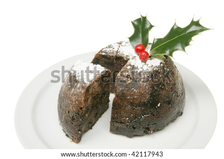 Christmas pudding on a plate isolated against white