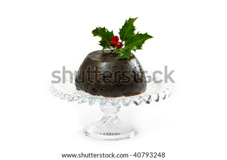 Christmas pudding with holly and berry decoration on white background