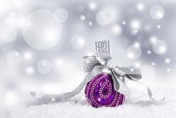 Christmas purple ball and silver ribbon.