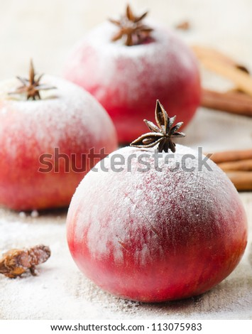 Christmas  red apples and spices on a wooden table