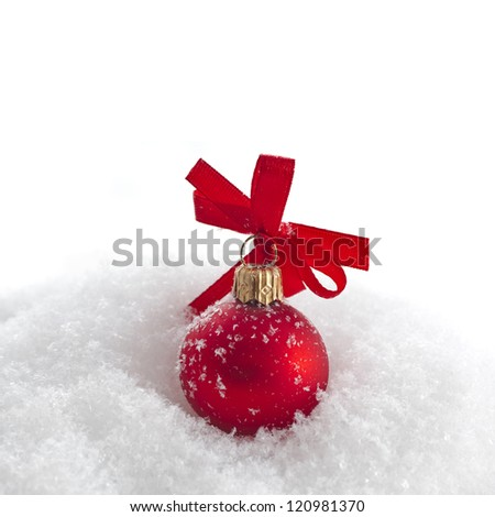 christmas red ball with ribbon bow on snow with copy space for your text on white background
