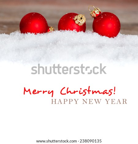 christmas red balls on snow with copy space