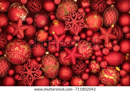 Christmas red bauble decorations forming a background.
