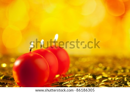 christmas red candles round shape in a row on bokeh golden background - stock photo