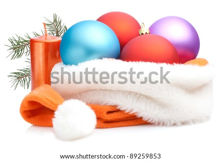 Christmas Red, Purple, Blue Baubles in Traditional Santa Hat, branch of tree and Candle Isolated on white background