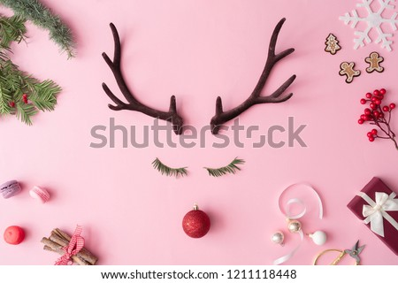 Christmas reindeer concept with presents, decoration, and winter things on pastel pink background. Minimal winter holidays idea. Flat lay top view composition. #1211118448