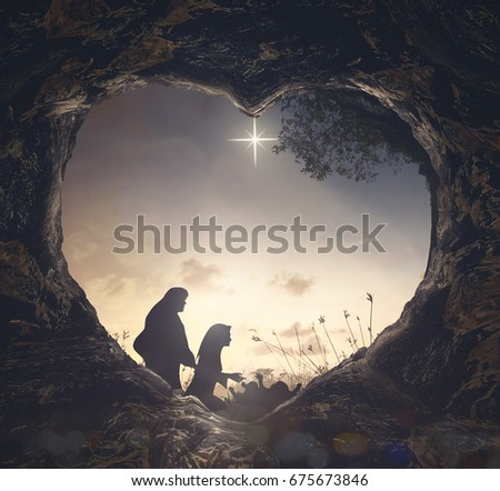 Christmas religious nativity concept: Silhouette mother Mary and father Joseph looking Jesus born in birth manger #675673846
