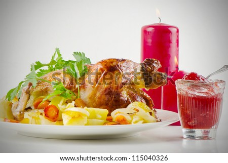Christmas roast chicken with potatoes and herbs
