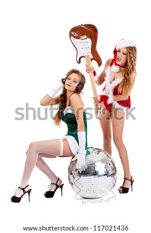 Christmas rock band with sexy girls isolated on a white background