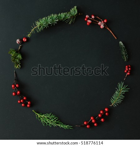 Christmas round frame made of natural winter things on dark blackboard. Flat lay. Christmas concept. #518776114