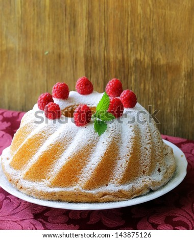 Christmas round sponge cake with raspberries
