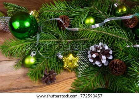christmas rustic background with green ornaments silver ribbon fir and pine cones on the - Green And Silver Christmas Decorations