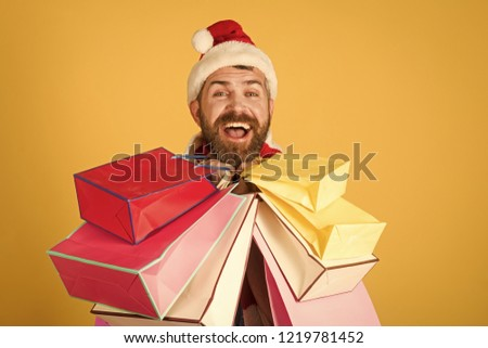40f63c45aed07 Christmas sale black friday concept. Hipster shopper smile in santa hat and  scarf. Winter