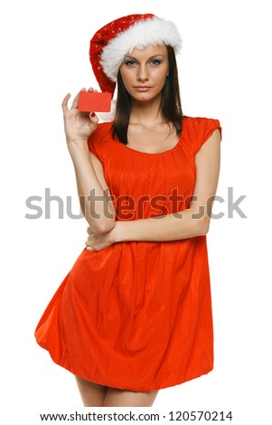 Christmas sale. Woman in Santa's hat holding empty credit card, over white background