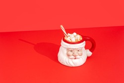 Christmas Santa Claus mug with hot cocoa, marshmallows, and a candy cane. Vintage and retro Christmas Kris Kringle mug for the Holidays.
