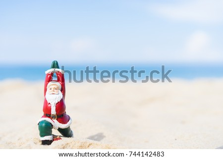 Christmas Santa claus practicing yoga at the ocean tropical sandy beach for ready back to work in Christmas night.Santa on the beach.