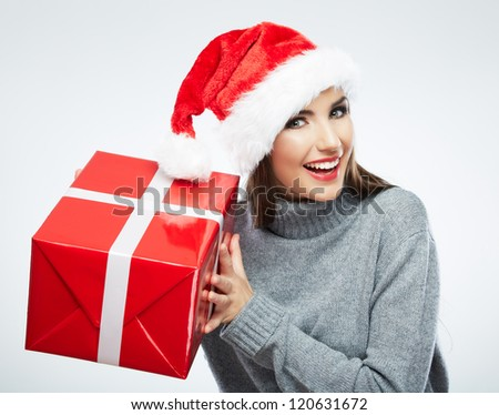 Christmas Santa hat isolated woman portrait hold christmas gift. Smiling happy girl on white background. - stock photo