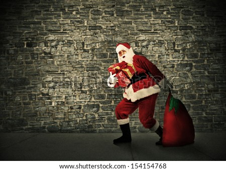 Christmas Santa with a bag. Gifts delivery concept.