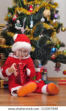 Christmas scene. A boy with a gift