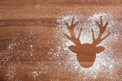 Christmas scene, reindeer head silhouette in wood and snow, copy space