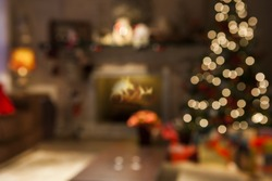 Christmas scene with tree gifts and fire in background