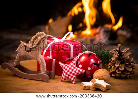 Christmas scene with tree gifts and fire in background #203338420