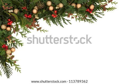 Christmas seasonal  border of holly, ivy, mistletoe, cedar leaf sprigs with pine cones and gold baubles over white background. #113789362