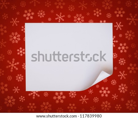 Christmas sheet of curved paper on red snowflakes background
