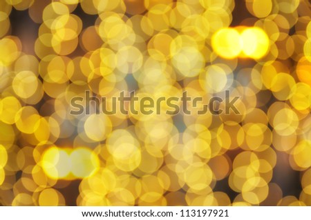 Christmas shiny bokeh in yellow golden  colors